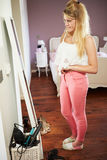 Teenage Girl Looking At Reflection In Bedroom Mirror Royalty Free Stock Photography