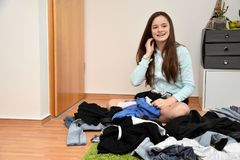 Teenage girl looking for something to wear