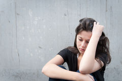 Teenage girl looking thoughtful about troubles Stock Photos