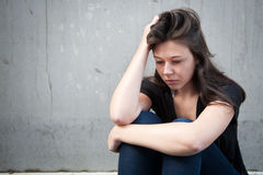 Teenage girl looking thoughtful about troubles Stock Photography