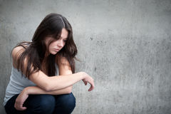 Teenage girl looking thoughtful about troubles Stock Image