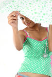 Teenage girl looking from the umbrella Stock Photo