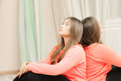 Teenage girl looking up closeup. Teenage girl looking up while leaning on the mirror closeup photo Stock Photos