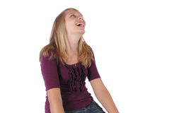 Teenage girl looking upward laughing studio Stock Images