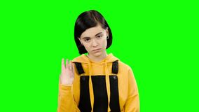 Teenage girl looks forward angrily. Green screen. Teenage girl looks forward angrily, she is angry with her friend. Green screen stock video footage