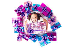 Teenage girl with lots of gifts Stock Image