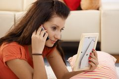 Teenage girl in love. Talking on mobile stock photography