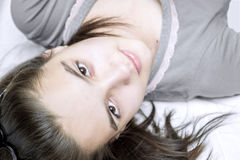 Teenage girl lying on the bed Royalty Free Stock Photos