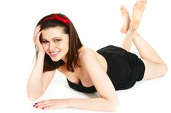 Teenage girl lying on floor Royalty Free Stock Photos