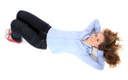 Teenage girl lying on floor Royalty Free Stock Images