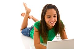 Teenage girl lying on front with computer Stock Photos