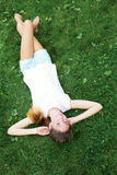 Teenage girl lying on the grass. woman relaxation outdo stock photography
