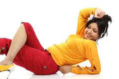 Teenage girl lying with headphones. Beautiful teenage girl lying on the floor relaxing listening to music Stock Photography