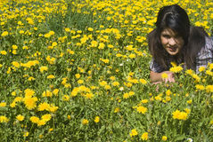 Teenage girl lying in spring meadow Stock Images