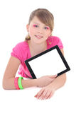 Teenage girl lying and using tablet pc isolated over white Stock Images