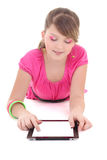 Teenage girl lying and using tablet pc over white Royalty Free Stock Image