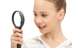 Teenage girl with magnifying glass Royalty Free Stock Images
