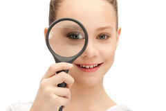 Teenage girl with magnifying glass Stock Photos