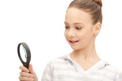Teenage girl with magnifying glass Royalty Free Stock Photos