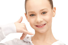 Teenage girl making a call me gesture Royalty Free Stock Photos
