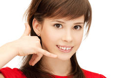 Teenage girl making a call me gesture Stock Photos