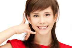 Teenage girl making a call me gesture Stock Photography