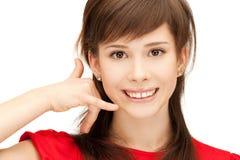 Teenage girl making a call me gesture Stock Image