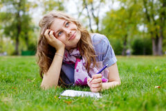 Teenage girl making homework in park Royalty Free Stock Images