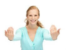Teenage girl making inviting gesture Stock Images