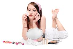 Teenage girl making make-up. Royalty Free Stock Photography