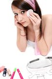 Teenage girl making make-up. Stock Photography