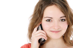 Teenage girl making phone call. Attractive teenage girl making a phone call. All on white background Stock Photography