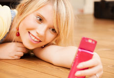 Teenage girl making self portrait with smartphone Royalty Free Stock Images