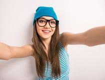 Teenage girl making selfie Royalty Free Stock Photos