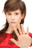Teenage girl making stop gesture Stock Photo
