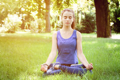Teenage girl meditates in nature Stock Photography