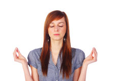 Teenage girl meditating, isolated on white Stock Images