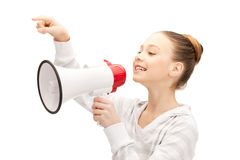 Teenage girl with megaphone. Bright picture of teenage girl with megaphone Stock Photos