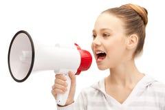 Teenage girl with megaphone Stock Photography