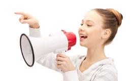 Teenage girl with megaphone Royalty Free Stock Photo