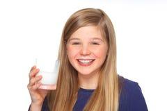 Teenage girl with milk and mustache stock image