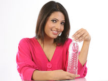 Teenage girl  with mineral water  bottle Royalty Free Stock Photos
