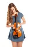 Teenage girl in mini dress with violin Stock Photo