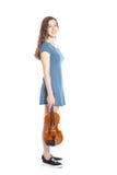 Teenage girl in mini dress with violin Stock Image