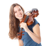 Teenage girl in mini dress with violin Royalty Free Stock Photography
