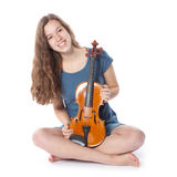 Teenage girl in mini dress with violin Royalty Free Stock Photos