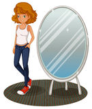 A teenage girl beside the mirror Stock Photography