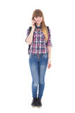 Teenage girl with mobile phone isolated on white Royalty Free Stock Images