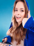 Teenage girl with mobile phone texting Stock Images