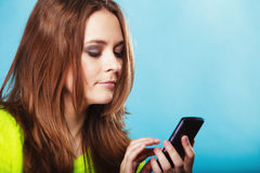 Teenage girl with mobile phone texting Royalty Free Stock Photos